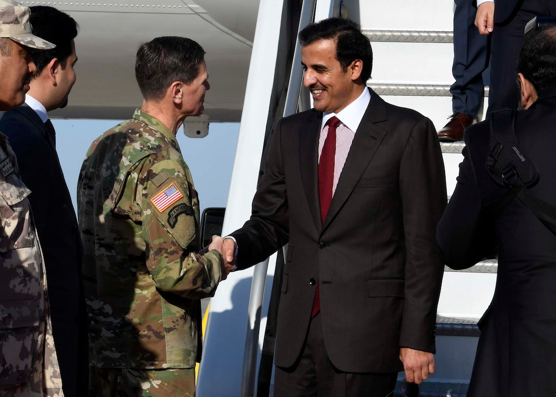 MacDill AFB, Fla. (April, 6, 2018) - His Highness, Tamim bin Hamad Al-Thani, the Emir of Qatar, shakes hands with U.S. Army Gen. Joseph Votel, commander, U.S. Central Command, upon arriving at MacDill Air Force Base. Tamim bin Hamad Al-Thani met Votel to discuss security issues of interest to both nations.  (U.S. Air Force photo by TSgt. Dana Flamer)