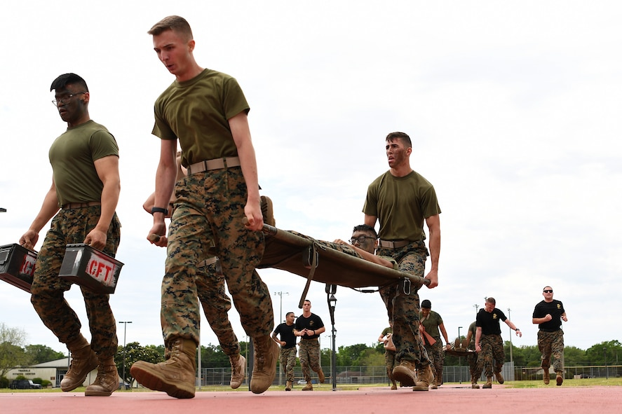 Members of the Keesler Marine Detachment participate in a timed casualty evacuation race during the 2nd Annual Warrior Day at the Triangle Track at Keesler Air Force Base, Mississippi, April 6, 2018. The race included carrying a team member on a stretcher, transporting ammo cans and water jugs. The event served to promote unit cohesion, camaraderie and small unit leadership. (U.S. Air Force photo by Airman 1st Class Suzie Plotnikov)