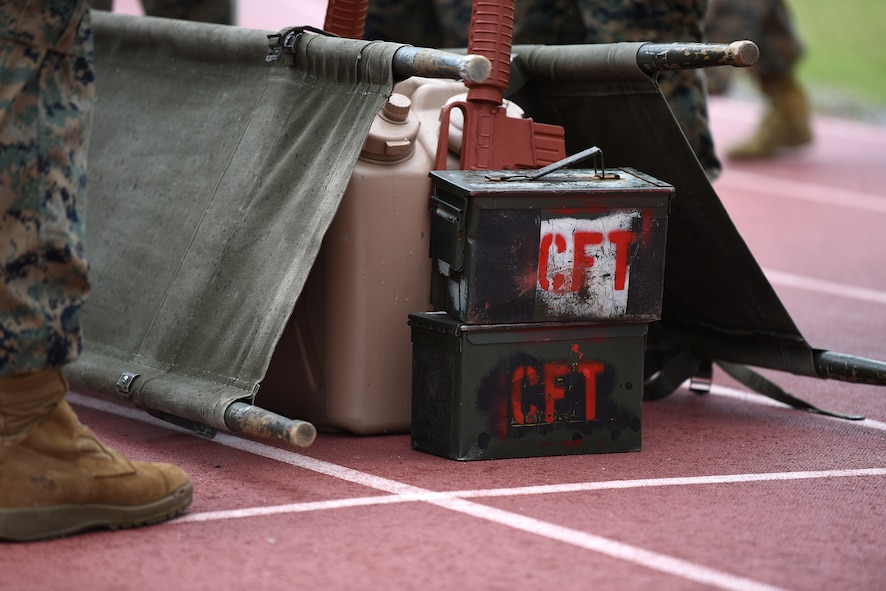Equipment for the casualty evacuation race is placed on the Triangle Track during the 2nd Annual Warrior Day at Keesler Air Force Base, Mississippi, April 6, 2018. The race included carrying a team member on a stretcher, transporting ammo cans and water jugs. The event served to promote unit cohesion, camaraderie and small unit leadership.  (U.S. Air Force photo by Airman 1st Class Suzie Plotnikov)