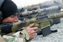 Army Spc. Arturo Dominguez, a native of Okeechobee, Fla., assigned to Charlie Troop, 1st Squadron, 40th Cavalry Regiment (Airborne), 4th Infantry Brigade Combat Team (Airborne), 25th Infantry Division, U.S. Army Alaska, fires at a target in the prone position with his M110 Semi-Automatic Sniper System on Statler range at Joint Base Elmendorf-Richardson, Alaska, April 6, 2018, during marksmanship training.  A sniper's main responsibility is to deliver discriminatory, highly accurate rifle fire against enemy targets that cannot be engaged successfully by the regular rifleman due to range, size, location, fleeting nature, or visibility.