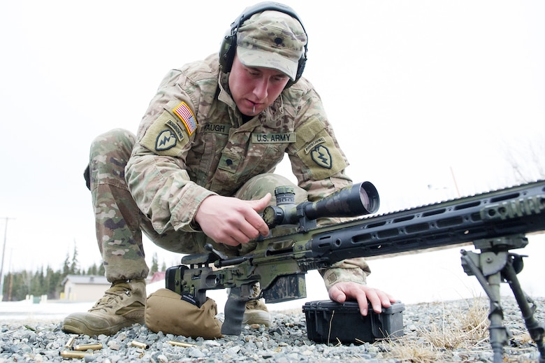 Army Spc. Eric Haugh, a native of Graham, Wash., assigned to Charlie Troop, 1st Squadron, 40th Cavalry Regiment (Airborne), 4th Infantry Brigade Combat Team (Airborne), 25th Infantry Division, U.S. Army Alaska, adjusts the scope on his M2010 Enhanced Sniper Rifle on Statler range at Joint Base Elmendorf-Richardson, Alaska, April 6, 2018, during marksmanship training.  A sniper's main responsibility is to deliver discriminatory, highly accurate rifle fire against enemy targets that cannot be engaged successfully by the regular rifleman due to range, size, location, fleeting nature, or visibility.