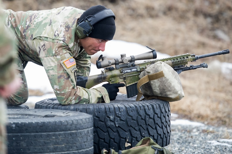 Army Spc. Arturo Dominguez, a native of Okeechobee, Fla., assigned to Charlie Troop, 1st Squadron, 40th Cavalry Regiment (Airborne), 4th Infantry Brigade Combat Team (Airborne), 25th Infantry Division, U.S. Army Alaska, gets in the prone position to fire a M110 Semi-Automatic Sniper System on Statler range at Joint Base Elmendorf-Richardson, Alaska, April 6, 2018, during marksmanship training.  A sniper's main responsibility is to deliver discriminatory, highly accurate rifle fire against enemy targets that cannot be engaged successfully by the regular rifleman due to range, size, location, fleeting nature, or visibility.