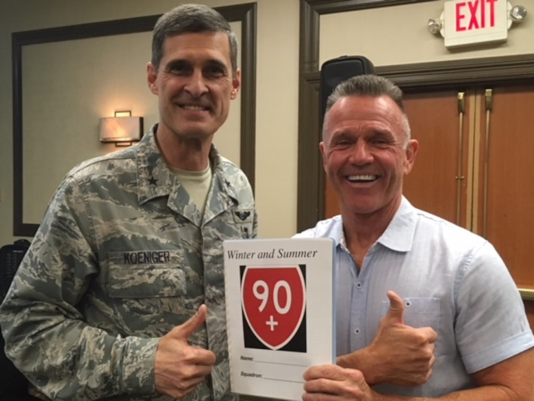 John Walters, 436th Force Support Squadron fitness program manager, poses with Brig. Gen. Mark Koeniger, 711th Human Performance Wing commander, at the Air Force Medical Service Operational Integrated Support meeting March 27, 2018, in San Antonio, Texas. Walter presented the history, scope, goals and metrics of the 90+ program during the meeting. (courtesy photo)