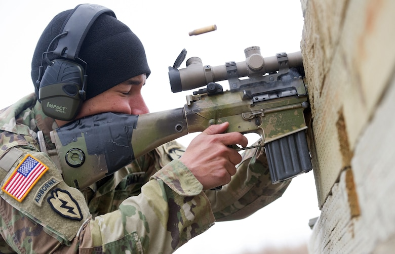 Army Spc. Arturo Dominguez, a native of Okeechobee, Fla., assigned to Charlie Troop, 1st Squadron, 40th Cavalry Regiment (Airborne), 4th Infantry Brigade Combat Team (Airborne), 25th Infantry Division, U.S. Army Alaska, fires a M110 Semi-Automatic Sniper System at a long-distance target on Statler range at Joint Base Elmendorf-Richardson, Alaska, April 6, 2018, during marksmanship training.  A sniper's main responsibility is to deliver discriminatory, highly accurate rifle fire against enemy targets that cannot be engaged successfully by the regular rifleman due to range, size, location, fleeting nature, or visibility.