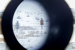 Long-distance targets are seen through a spotting scope as paratroopers assigned to the 1st Squadron, 40th Cavalry Regiment (Airborne), 4th Infantry Brigade Combat Team (Airborne), 25th Infantry Division, U.S. Army Alaska, hone marksmanship skills with M110 Semi-Automatic Sniper Systems and M2010 Enhanced Sniper Rifles on Statler range at Joint Base Elmendorf-Richardson, Alaska, April 6, 2018.  A sniper's main responsibility is to deliver discriminatory, highly accurate rifle fire against enemy targets that cannot be engaged successfully by the regular rifleman due to range, size, location, fleeting nature, or visibility.