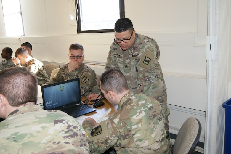 (Standing) Sgt. 1st Class Heriberto Rivera-Cassanova, an 80th Training Command instructor, teaches Army Reserve and National Guard Soldiers measurement calculations as part of the 12R Interior Electrician course at The Army School System Training Center Dix, New Jersey, March 31, 2018.