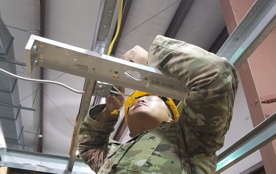 An Army National Guard Soldier learns how to install a light fixture during the 12R Interior Electrician course taught by instructors from the 80th Training Command and 102nd Training Division (Maneuver Support) at The Army School System Training Center Dix, New Jersey, March 29, 2018.