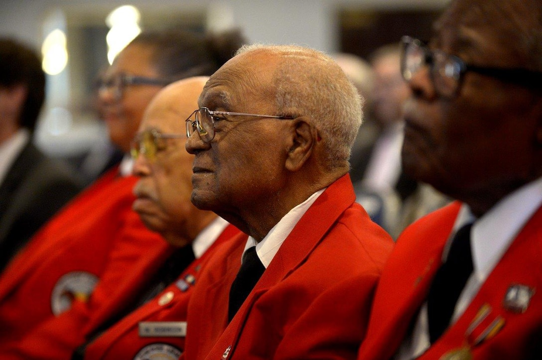 Tuskegee Airmen listen to former Secretary of the Air Force Deborah Lee James during a portrait unveiling ceremony at Joint Base Anacostia-Bolling, Washington, D.C., April 6, 2018. During her remarks, James spoke about how both past and present Airmen have influenced her career. (U.S. Air Force photo by Staff Sgt. Rusty Frank)