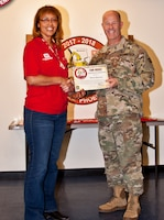 A certificate is presented to Maria Buckner, Honolulu District USACE by Col. Eric McFadden, RFO commander, for her work during the Northern California Wildfires Debris Removal Mission.