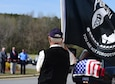 A member of the Patriot Guard Riders of North Carolina holds a POW/MIA flag during Col. Edgar Davis' funeral ceremony April 6, 2018, in Goldsboro, North Carolina. After being shot down over Laos during the Vietnam War in 1968, a Laotian villager buried Davis' remains. In 2015, the villager's son reached out regarding the location of the remains and the Defense POW/MIA Accounting Agency recovered Davis' remains in 2017. (U.S. Air Force photo by Senior Airman Christian Clausen)
