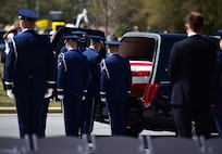 Members of the Seymour Johnson Honor Guard transfer the remains of Col. Edgar Davis April 6, 2018, in Goldsboro, North Carolina. Davis was shot down during a night photo-reconnaissance mission over Laos during the Vietnam War. After initial rescue efforts were unsuccessful, he was assumed dead and his remains stayed missing for 50 years. (U.S. Air Force photo by Senior Airman Christian Clausen)