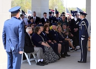 A Seymour Johnson Air Force Base Honor Guardsmen presents a flag in honor of Col. Edgar Davis during his funeral ceremony April 6, 2018, Goldsboro, North Carolina. Davis was shot down during a night photo-reconnaissance mission over Laos during the Vietnam War. After initial rescue efforts were unsuccessful, he was assumed dead and his remains stayed missing for 50 years. (U.S. Air Force photo by Senior Airman Christian Clausen)
