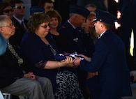 A Seymour Johnson Air Force Base Honor Guardsmen presents a flag in honor of Col. Edgar Davis to his daughter, Martha Morton, during his funeral ceremony April 6, 2018, Goldsboro, North Carolina. Davis was shot down during a night photo-reconnaissance mission over Laos during the Vietnam War. After initial rescue efforts were unsuccessful, he was assumed dead and his remains stayed missing for 50 years. (U.S. Air Force photo by Senior Airman Christian Clausen)
