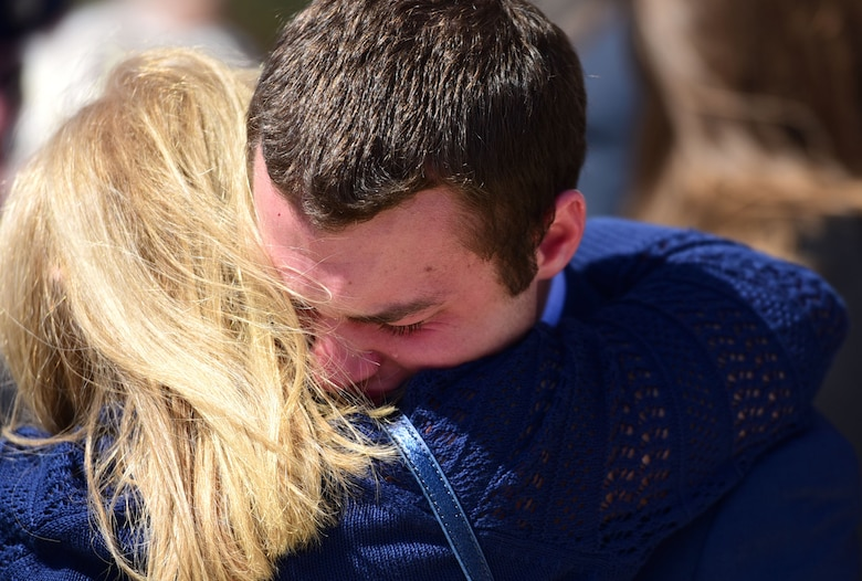 Matt Davis, grandson of Col. Edgar Davis embraces a family member after his grandfather's funeral ceremony April 6, 2018, Goldsboro, North Carolina. Davis served as an RF-4C Phantom navigator during the Vietnam War assigned to the 11th Tactical Reconnaissance Squadron. The unit exists today as the 11th Attack Squadron flying the MQ-9 Reaper. (U.S. Air Force photo by Senior Airman Christian Clausen)