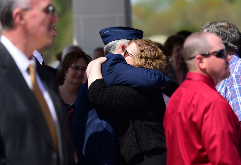 Members of Col. Edgar Davis embrace each other after his funeral ceremony April 6, 2018, Goldsboro, North Carolina. Davis was shot down during a night photo-reconnaissance mission over Laos during the Vietnam War. After initial rescue efforts were unsuccessful, he was assumed dead and his remains stayed missing for 50 years. (U.S. Air Force photo by Senior Airman Christian Clausen)