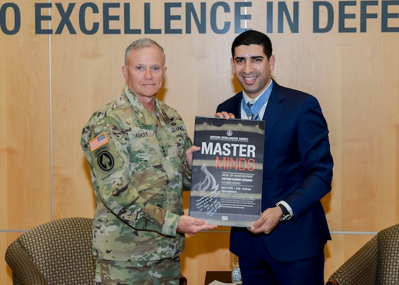 DIA Director Army Lt. Gen. Robert Ashley presents Medal of Honor recipient retired Army Capt. Florent Groberg with a token of appreciation.