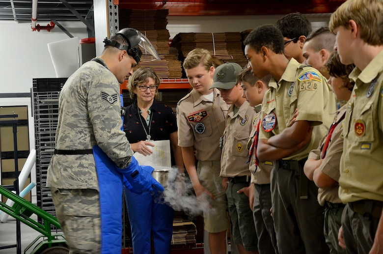 Staff Sgt. Leland La Kemper, a radiochemistry lab technician at the Air Force Radiochemistry Laboratory, Patrick AFB, Fla., shows a group of Boy Scouts the effects of liquid nitrogen.  La Kemper was one of several Airmen who volunteered to help scouts from across Central Florida earn their Nuclear Science Merit Badge March 31, 2018.  (U.S. Air Force photo by Susan A. Romano)