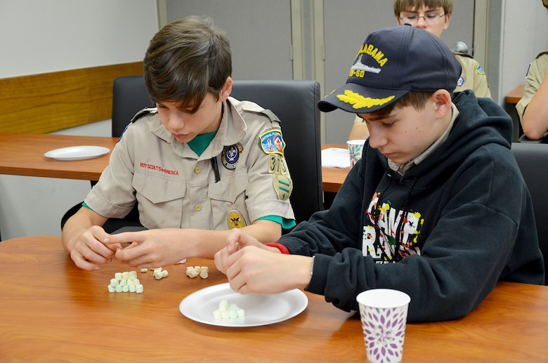Robbie Naberhaus (left) and Jack Gander, both 8th graders at Ascension Catholic School and members of Boy Scout Troop #373 in Melbourne, Fla., attempt to build an atomic model using miniature marshmallows during an event hosted by the Air Force Technical Applications Center, Patrick AFB, Fla., March 31, 2018.  The boys were two of 98 scouts who traveled to the base to earn their Nuclear Science Merit Badge with the help of Airmen from the Department of Defense's sole nuclear treaty monitoring center.  (U.S. Air Force photo by Susan A. Romano)