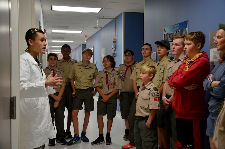 Capt. Sky Thai (left), a physicist at the Air Force Technical Applications Center, Patrick AFB, Fla., briefs a group of Boy Scouts about his job at the center's Ciambrone Radiochemistry Lab March 31, 2018.  Thai spearheaded the effort to help 98 scouts from across Central Florida earn their Nuclear Science Merit Badge.  (U.S. Air Force photo by Susan A. Romano)