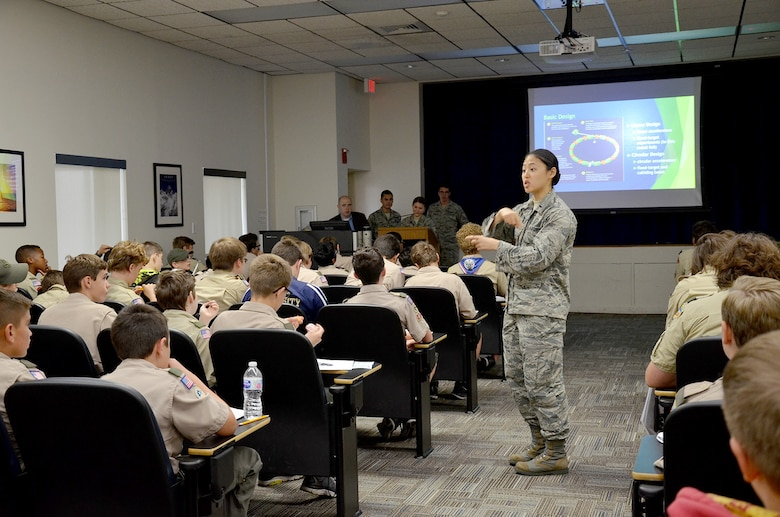 First Lt. Pamela Zhang, a chemist with the Air Force Technical Applications Center, describes how a particle accelerator works to a group of Boy Scouts from Central Florida.  Zhang was one of several volunteers from the nuclear treaty monitoring center who volunteered to help the scouts earn their Nuclear Science Merit Badge March 31, 2018.  (U.S. Air Force photo by Susan A. Romano)