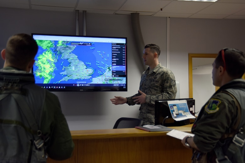 The 48th Operations Support Squadron mission integration function NCO in charge, center, briefs 494th Fighter Squadron pilots about the day's weather before takeoff at Royal Air Force Lakenheath, England, March 20. Before each flight, pilots are briefed on the weather conditions including cloud coverage, visibility, and wind speed and direction, so that they know what to expect while they're in the air and can plan accordingly. (U.S. Air Force photo/Senior Airman Abby L. Finkel)