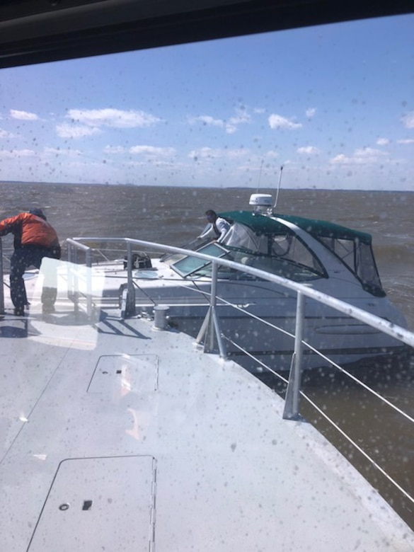 Crew aboard the Survey Vessel CATLETT help a boater come aboard from his disabled vessel in the Chesapeake Bay during a rescue operation Thursday April 5, 2018. The CATLETT's U.S. Army Corps of Engineers crew was conducting a routine condition survey of the Tolchester Channel when she responded to a mayday call, rescuing the boater and bringing him back to the Corps of Engineers' facility at Fort McHenry where local emergency medical services assisted him further.