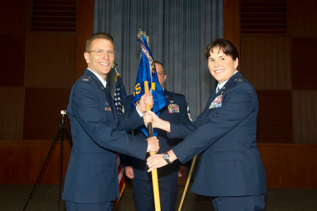 Lt. Col. Summer A. Fields takes the 13th Reconnaissance Squadron guidon from Col. David S. Edwards, 726th Operations Group commander at Creech Air Force Base, Nevada, April 7 at Beale Air Force Base, California.