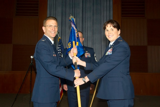 Lt. Col. Summer A. Fields takes the 13th Reconnaissance Squadron guidon from Col. David S. Edwards, 726th Operations Group commander at Creech Air Force Base, Nevada, April 7 at Beale Air Force Base, California. Prior to assuming command, she served as the 13th RS director of operations for over four years. (U.S. Air Force photo by Senior Airman Tara R. Abrahams)