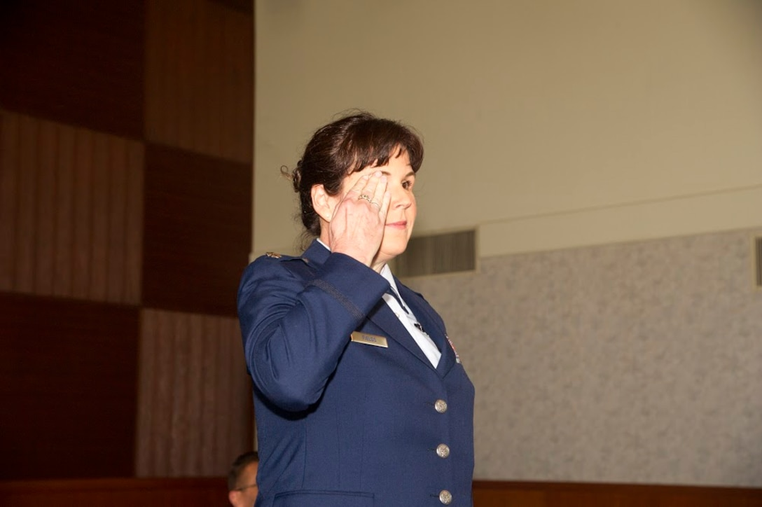 Lt. Col. Summer A. Fields gives her first salute as the commander of the 13th Reconnaissance Squadron April 7 at Beale Air Force Base, California.