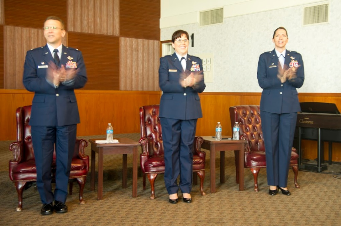 (Left to right) Col. David S. Edwards, 726th Operations Group commander at Creech Air Force Base, Nevada; Lt. Col. Summer A. Fields, 13th Reconnaissance Squadron commander; and Lt. Col. Karyn L. Christen, 726th OG deputy commander, sing and clap to the Air Force song April 7 at Beale Air Force Base, California.