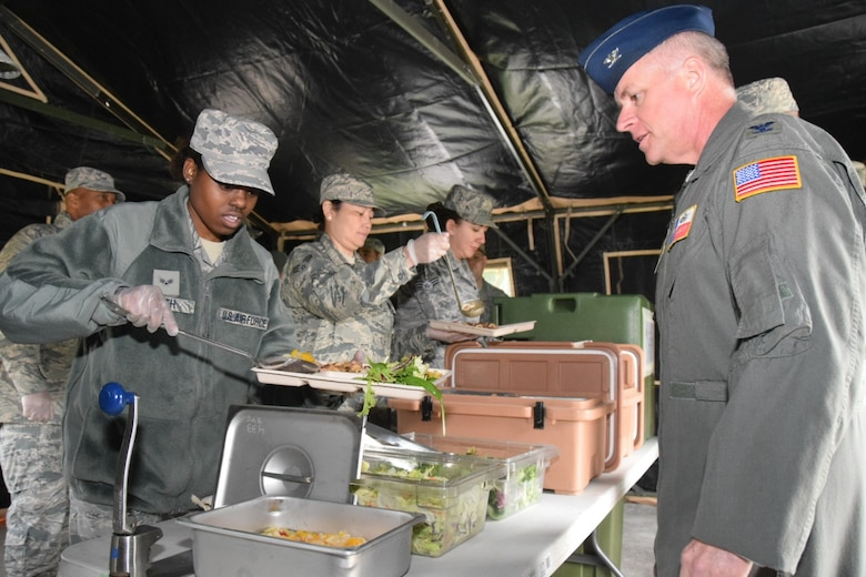 Senior Airman Chelsea Smith, 433rd Force Support Squadron food services specialist, serves lunch to Col. David Scott, 433rd Airlift Wing vice commander, from a Single Pallet Expeditionary Kitchen April 7, 2018. The sustainment flight served a lunch that consisted of southwestern chicken, white rice, garden salad, fruit cocktail and red velvet cake to Alamo Wing leadership. (U.S. Air Force photo by Tech Sgt. Carlos J. Treviño)