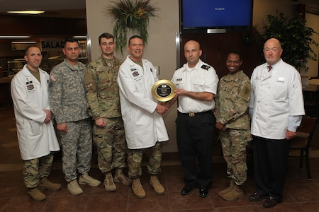 Soldiers and staff from the Demon Diner were awarded a golden plate by the Philip A. Connelly Awards Program judges March 30 at Fort Riley, Kansas. The diner was chosen as one of the six best dining facilities in the Army.