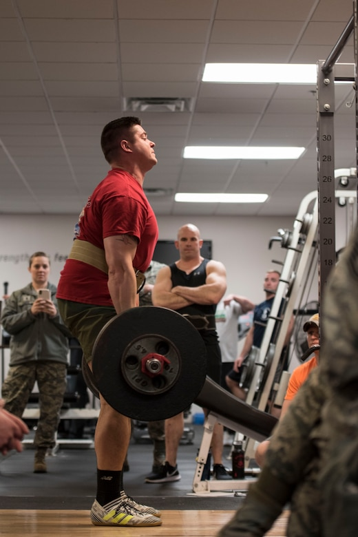 """Tech. Sgt. Jordan Soltis, a loadmaster at the 167th Airlift Wing, performs a deadlift during a weightlifting challenge held at the base gym. Soltis had an impressive max deadlift of 535 lbs.  Soltis said, """"It was nice to see the turnout of people interested and those participating."""" (U.S. Air National Guard photo by Staff Sgt. Jodie Witmer)"""