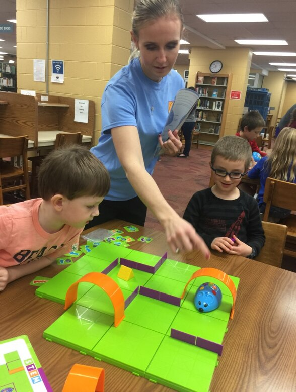 Olga Oakley shows children how to use Colby, the robotic coding mouse, during a program at the Coffee County Library. The Hands-On Science Center Board of Directors recently hired Oakley to direct the Arnold Air Force Base STEM program.