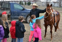 Mark Morgan and his 11-year-old horse, Chip, were among 10 stations for Seitz Elementary School students to visit during the first Careers on Wheels event held at Fort Riley, Kansas, March 30 in the school field.