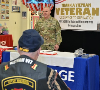 Command Sgt. Maj. Andrew Bristow II, Fort Riley Garrison senior noncommissioned officer, speaks to Vietnam Veterans and their family members during a brief ceremony at the Fort Riley main exchange March 29 on National Vietnam Veterans day.