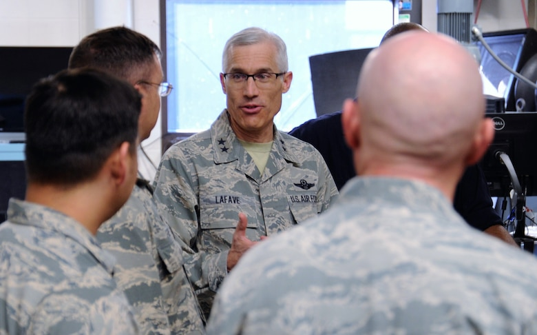 Maj. Gen. Craig La Fave, the 22nd Air Force commander, listens to 302nd Airlift Wing reservists during his tour of the wing's aircraft maintenance facilities at Peterson Air Force Base, Colorado, April 8, 2018. La Fave spent part of the morning learning about the squadron's challenges and accomplishments. (U.S. Air Force photo by Staff Sgt. Frank Casciotta)