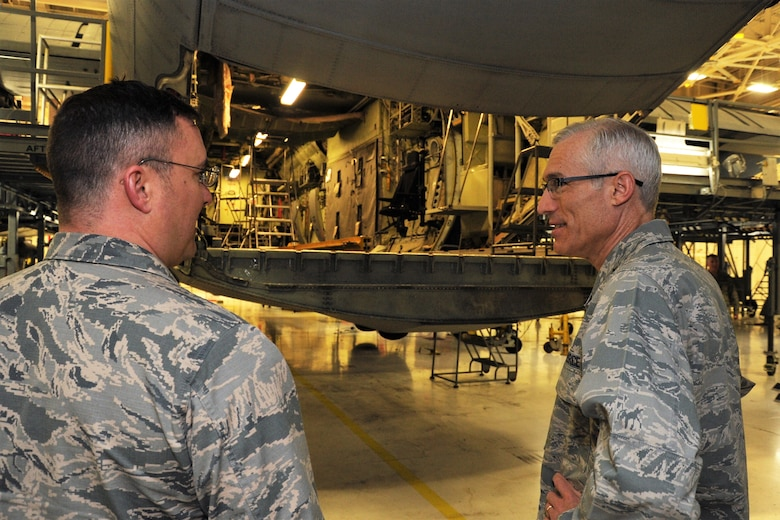 Maj. Gen. Craig La Fave, the 22nd Air Force commander, speaks with Maj. John Fite, the 302nd Maintenance Squadron commander, while visiting 302nd Airlift Wing Reserve Citizen Airmen at Peterson Air Force Base, April 8, 2018. La Fave spent part of the morning learning about the squadron's challenges and accomplishments. (U.S. Air Force photo by Staff Sgt. Frank Casciotta)