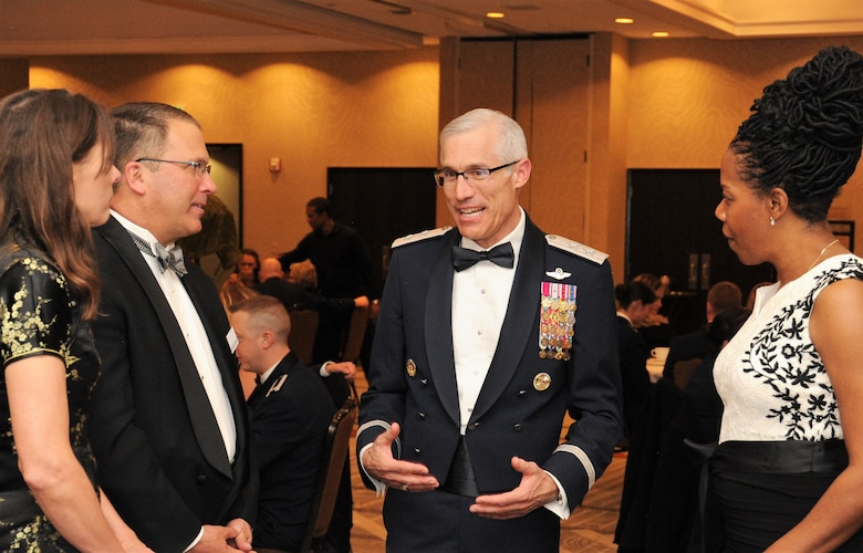Maj. Gen. Craig La Fave, the 22nd Air Force commander, speaks with Steve Kaczmarek the Pikes Peak Community College foundation board president, his wife, Christy, left, and Dr. Regina Lewis, the PPCC Department of Communications chair, during the 302nd Airlift Wing's 2017 Annual Awards Banquet held in Colorado Springs, Colorado, April 7, 2018. The Reserve wing celebrated the Air Force Reserve 70th Anniversary in addition to recognizing its top performers at this year's banquet. (U.S. Air Force photo by Staff Sgt. Frank Casciotta)