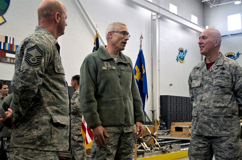 Maj. Gen. Craig La Fave, 22nd Air Force commander, speaks with Senior Master Sgts. Augusto Goncalves (right) and Robert Gage (left), both with the 39th Aerial Port Squadron, April 7, 2018 at Peterson Air Force Base, Colorado. La Fave visited the 302nd Airlift Wing to see its mission firsthand and to talk with Reserve Citizen Airmen at their units. (U.S. Air Force photo by Staff Sgt. Justin Norton)