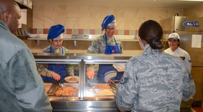 Maj. Gen. Craig La Fave, the 22nd Air Force commander, and Chief Master Sgt. Imelda Johnson, the 22nd AF command chief, serve lunch to 302nd Airlift Wing reservists at Peterson Air Force Base, Colorado, April 7, 2018. La Fave and Johnson visited 302nd Airlift Wing for a firsthand look at the mission. (U.S. Air Force photo by Maj. Jolene Bottor-Ortiona)