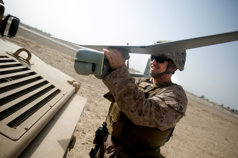 Marine Corps Sgt. John Verhage III aids in the employment of remote sensor systems and unmanned aerial surveillance assets to help detect the movement of enemy personnel and vehicles prior to a sensor emplacement mission near Bost Airfield, Afghanistan.