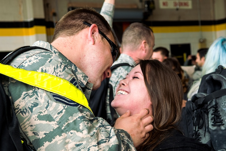 An Airman from the 4th Fighter Wing greets his spouse upon returning from deployment, April 10, 2018, at Seymour Johnson Air Force Base, North Carolina.