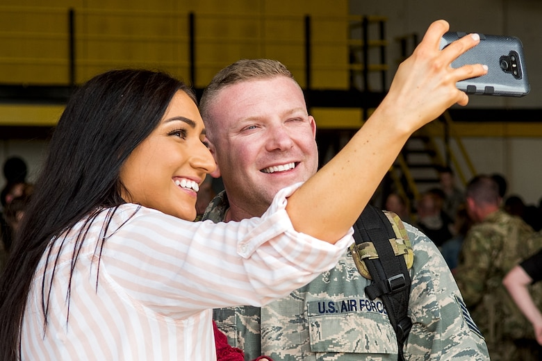 A member of the 4th Fighter Wing and his wife take a selfie during a homecoming event, April 10, 2018, at Seymour Johnson Air Force Base, North Carolina.