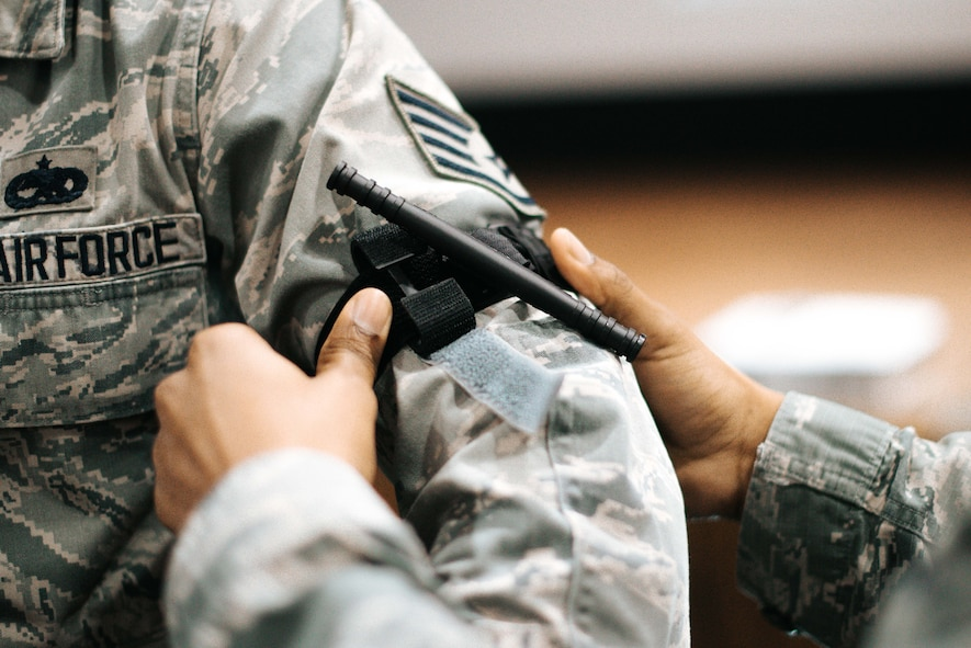 Senior Airman Dean Adamczyk, 11th Civil Engineer Squadron fire inspector, places a tourniquet onto Staff Sgt. Michael Wilson, Air Force Legal Operations Agency paralegal, during a bleeding control kit training session at the base theater on Joint Base Andrews, Md., March 29. 2018. During the training, personnel learned hands-on lifesaving skills utilizing resources located in each bleeding control kit. Each included gloves, gauze, trauma dressing, sheers, tourniquets and easy-to-follow instructions.