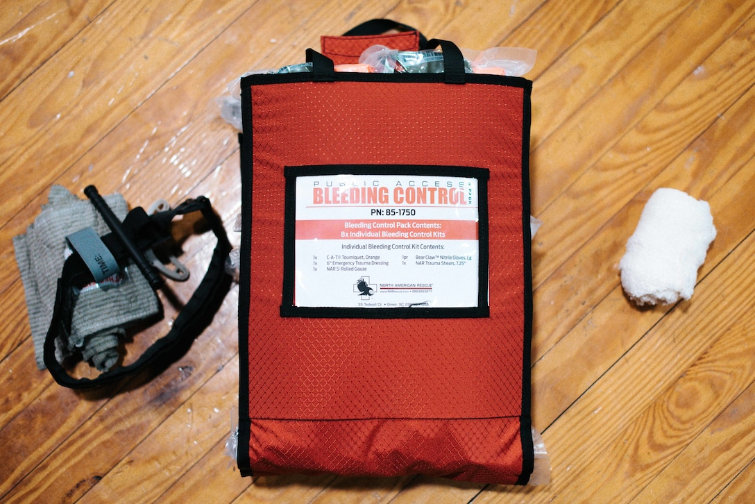 """A bleeding control kit is displayed during a bleeding control kit training session at the base theater on Joint Base Andrews, Md., March 29. 2018. The event was a part of the """"Stop the Bleed"""" campaign, which empowers bystanders to understand and implement simple methods to stop or slow life-threatening bleeding, particularly during trauma events."""