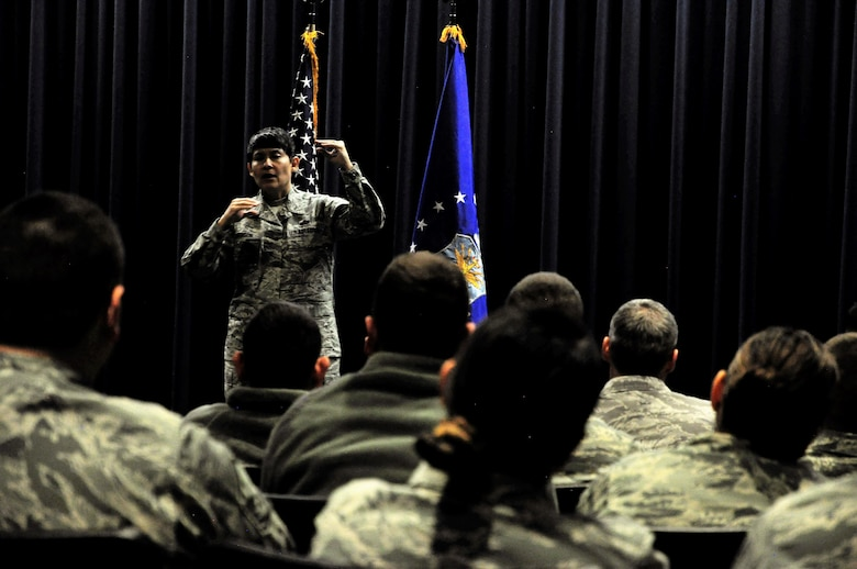 Chief Master Sgt. Imelda Johnson, 22nd Air Force command chief, speaks to 302nd Airlift Wing reservists during an enlisted town hall meeting April 7, 2018 at Peterson Air Force Base, Colorado. During Johnson's remarks, Airmen had the chance to ask questions and receive feedback on matters impacting the enlisted force. (U.S. Air Force photo by Staff Sgt. Justin Norton)