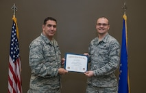 Spring CCAF graduates receive diplomas during ceremony with 932nd Airlift Wing commander, Col. Raymond Smith.