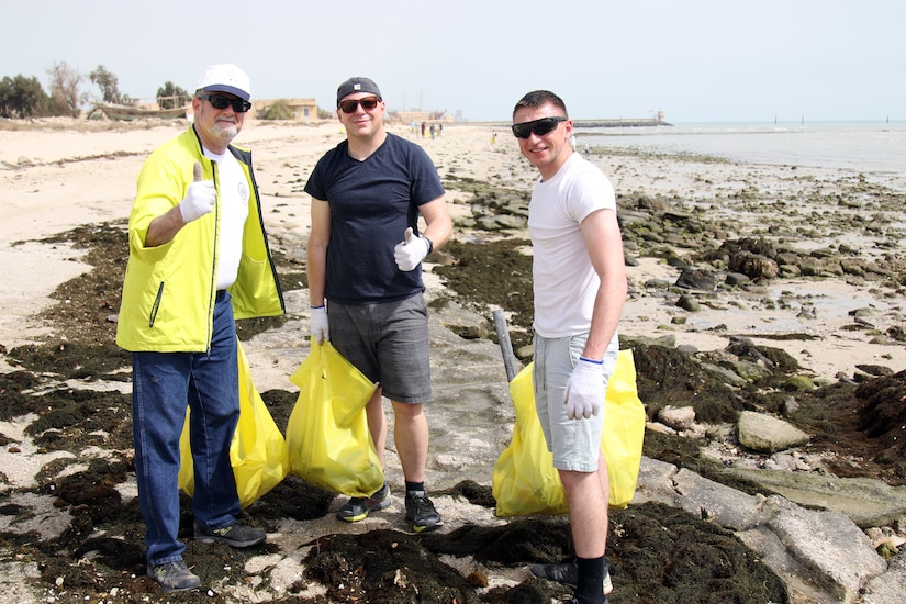 U.S. Ambassador to Kuwait Lawrence Silverman (left) pauses during a cleanup at Anjafa Beach for a photo with Pa. Army National Guard Soldiers Sgt. Timothy Reed (center) of Latrobe and Spc. Anthony Massaro of Philadelphia on April 7, 2018. Reed and Massaro are with Charlie Company, Headquarters and Headquarters Battalion, 28th Infantry Division and are deployed to Kuwait as part of Task Force Spartan. The event was the latest in an ongoing effort to rid Kuwait beaches of pollution.