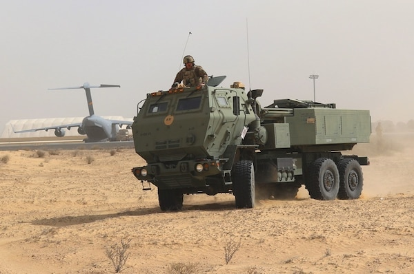 Soldiers of Alpha Battery, 2nd Battalion, 130th Field Artillery, 75th Field Artillery Brigade, 35th Infantry Division, from the Kansas National Guard, work with U.S. Air Force crew to load two M142 High Mobility Artillery Rocket Systems (HIMARS), pre-dawn, in preparation for the Operation Diamond Torrent exercise, at an airbase in the United Arab Emirates, Jan. 21. Operation Diamond Torrent demonstrated the capabilities of the C-17 and the HIMARS as an operational strategic strike package that can rapidly deploy and infiltrate to deliver a fast, flexible and lethal combination where ever needed.